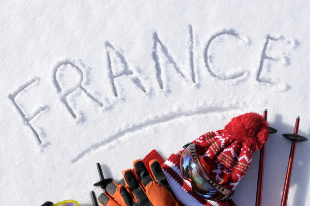 France skiing writing in snow David Franklin shutterstock_248544910