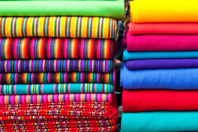 Ecuador Otovalo Market textiles Boyd Hendrikse shutterstock_177766172