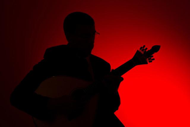 Portugal Lisbon fado music guitar player silhouette rui vale sousa shutterstock_394449931