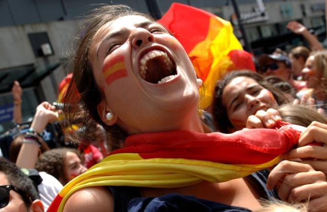 Spain sports fan with flag Sergei Bachlakov shutterstock_56968105