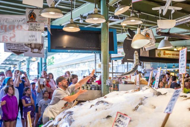 USA Washington Seattle Pike Place Market fishmonger f11photo shutterstock_205594996