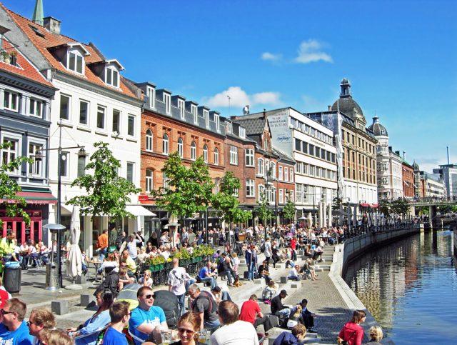 L2F Mar 17 pic Denmark Aarhus crowds along canal shutterstock_449363242