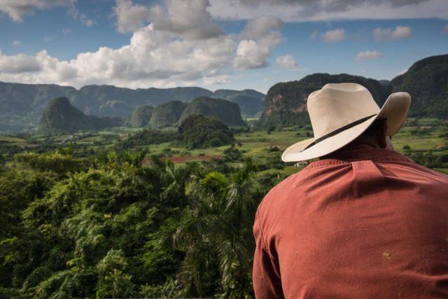 L2F Apr 17 pic Cuba Pinar del Rio Viñales mogotes with cowboy Shutterstock