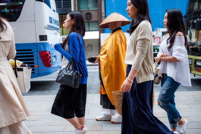 L2F May 17 pic Japan Palka Buddhist monk amid walking girls