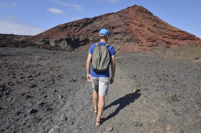 L2F Oct 17 pic Spain Canary Islands Lanzarote Timanfaya man hiking shutterstock_692143543