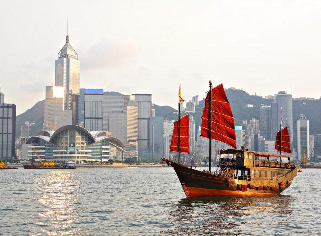 L2F Mar 18 pic China Hong Kong skyline Victoria Harbour junk shutterstock_94856134