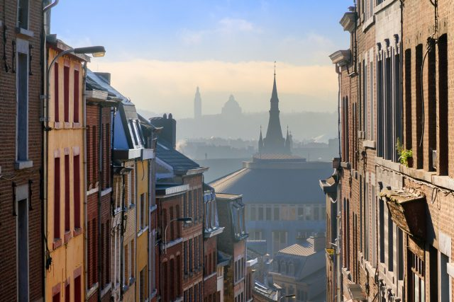 Beautiful urban cityscape see through with a view over Liege, Belgium, from one of the street leading up the hill on a sunny winter morning