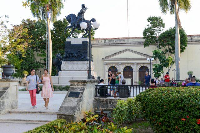 Camaguey, Cuba - 11 January 2016: People walking in front of the Ignacio Agramonte monument at Ignacio Agramonte Park in Camaguey, Cuba