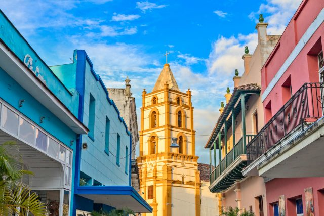 Nuestra Senora de la Soledad church and Spanish colonial colorful decorated houses with balconies, in the center of Camaguey, Cuba