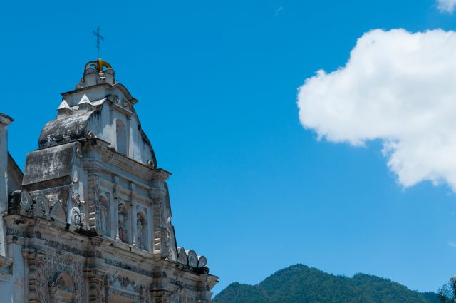White Big Church Beside in front of mountains under blue sky with one cloud in Quetzaltenango Guatemala