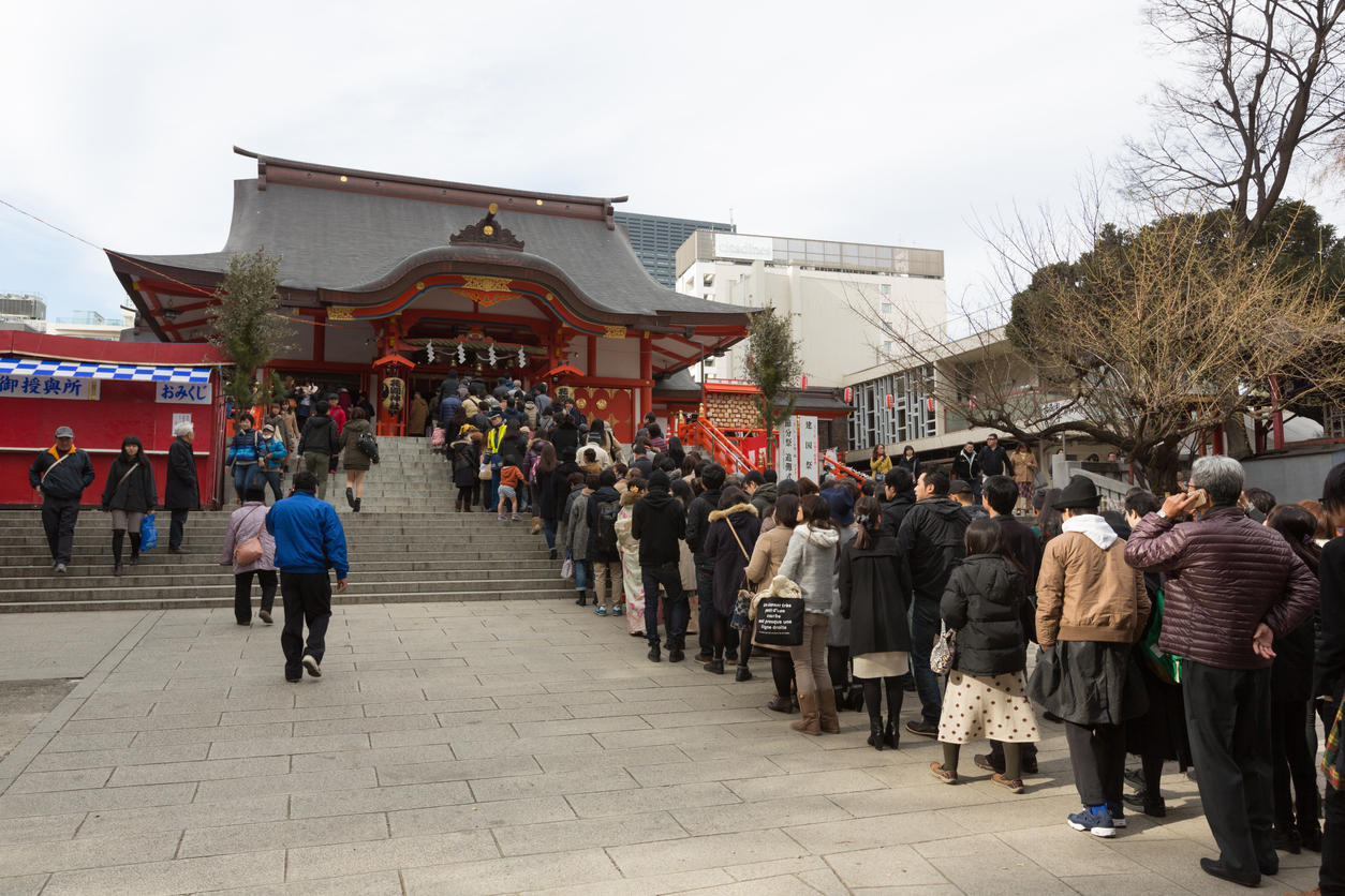 Tokyo, Japan - January 2, 2016 : People at Hanazono Shrine in Shinjuku, Tokyo, Japan. Japanese go to Shrine to ask for health, wealth and divine protection during the New year.