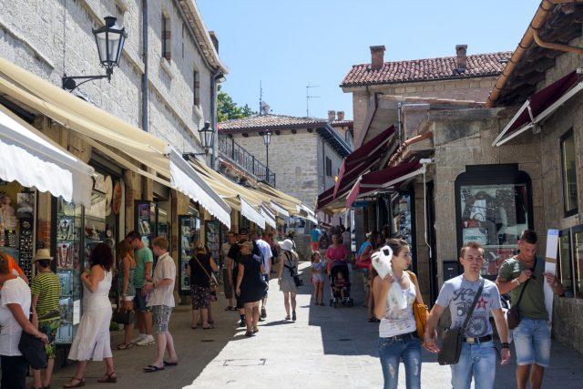 City of San Marino, San Marino - August 12, 2013: the tourists walking along the narrow streets of San Marino, with numerous duty free shops.
