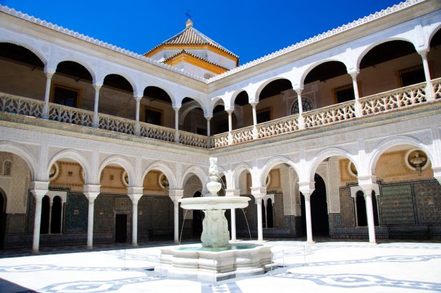 """""""Seville, Spain - June 13, 2012: The patio of La Casa de Pilatos, in Seville. The building is a precious palace in mudejar spanish style, the costruction was started in XV sec. by Pedro Enriquez de Quiñones and his wife Catalina de Rivera . At the center of the patio, a nice fountain."""""""