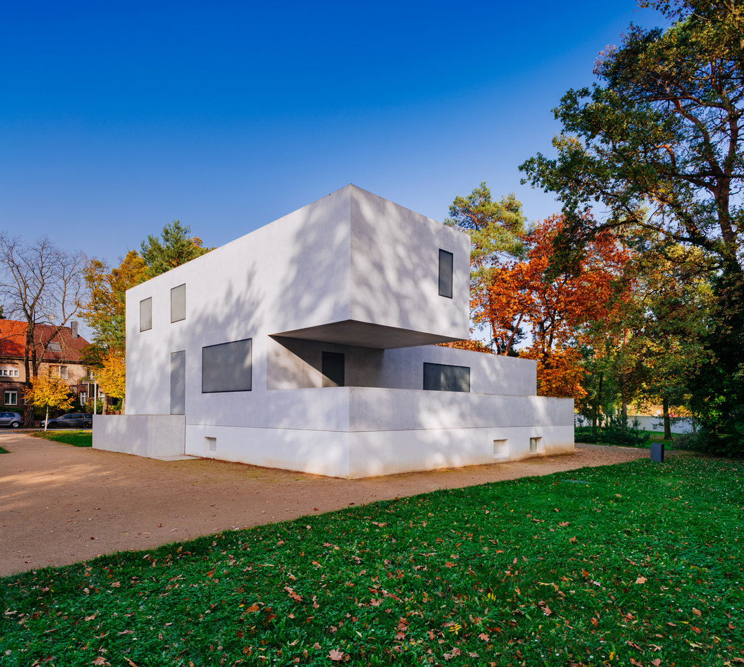 """Dessau, Germany - October 16,2017: Looking at the master houses called """"Walter Gropius house"""". Walter Gropius himself has mostly designed the Master's Houses. The building is now the ticket office. The Bauhaus is regarded as a key work of European modernism. The art and architecture school founded by Walter Gropius will be 100 years old in 2019. Since 1996 the Bauhaus Dessau is a part of the Unesco World Heritage Site."""