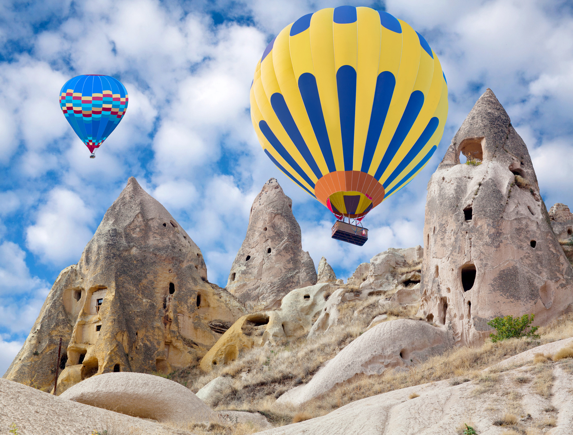 Colorful hot air balloons flying over the valley in Cappadocia, Anatolia, Turkey. Cappadocian Region with its valley, canyon, hills located between the volcanic mountains Erciyes, Melendiz and Hasan.
