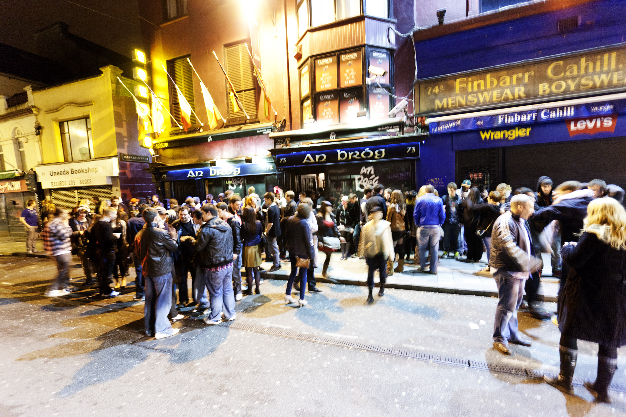 Cork, Ireland - January 21, 2012: Revellers enjoy a Saturday night out in Cork. People stand around talking after leaving nearby bars and clubs at closing time.
