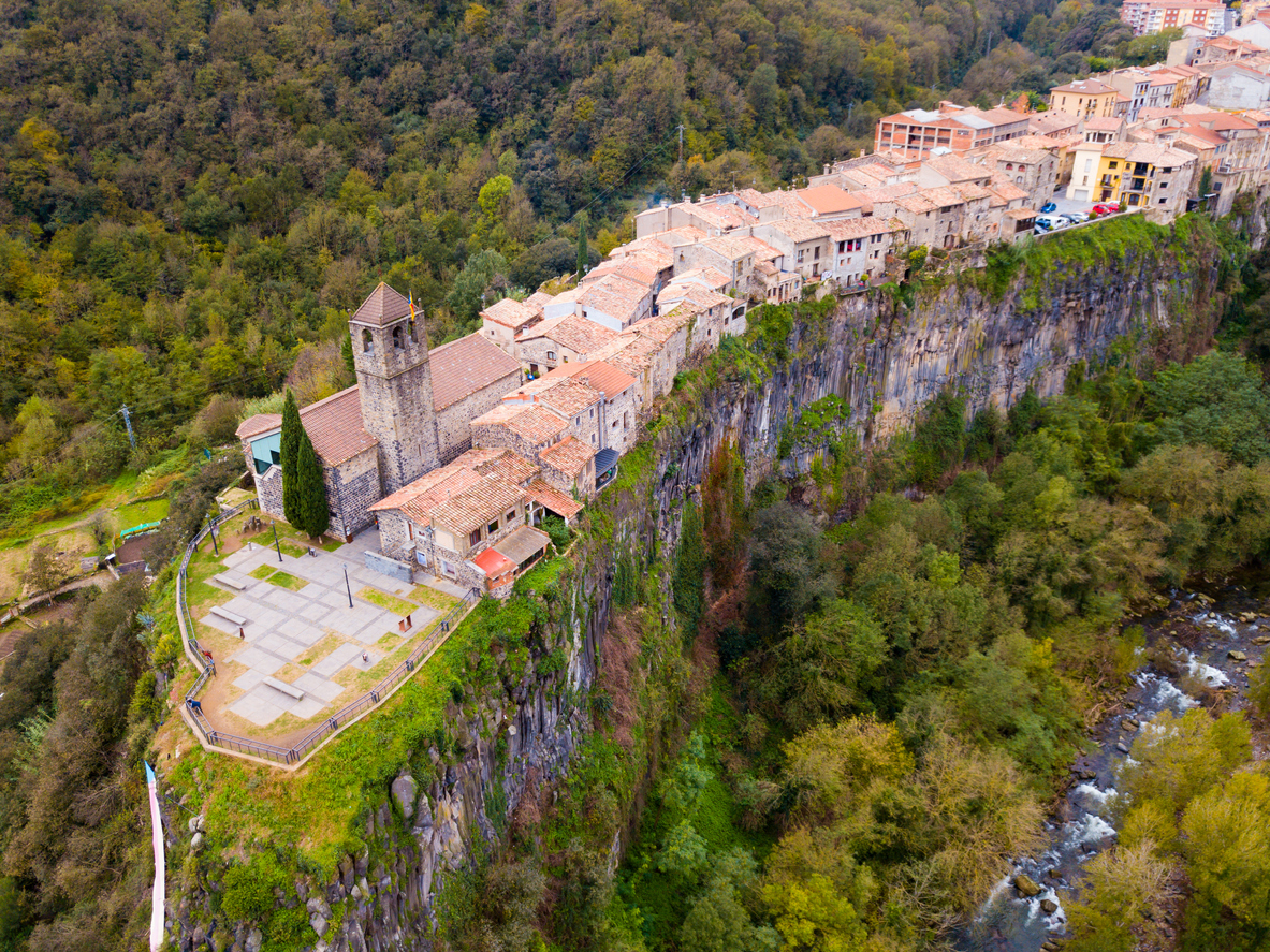 Aerial view of Castellfollit de la Roca, medieval Catalan hamlet on cliff on autumn day