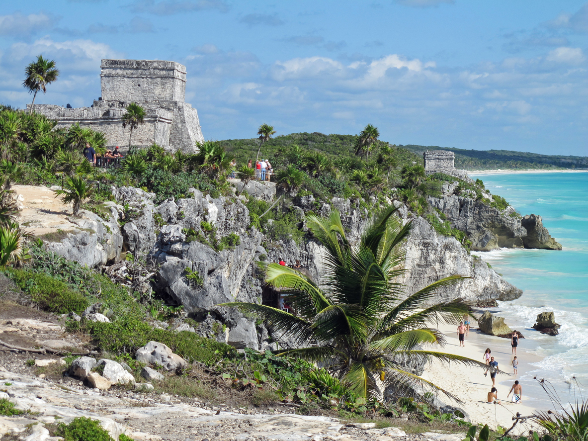 Tulum, Mexico - January 27, 2011: Tourists explore the ancient Mayan ruins and beach at Tulum, Mexico.