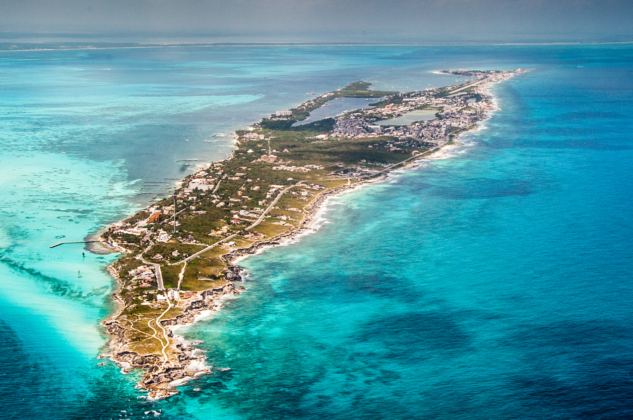 Aerial view of Isla Mujeres and island very close to Cancun. Caribbean waters.