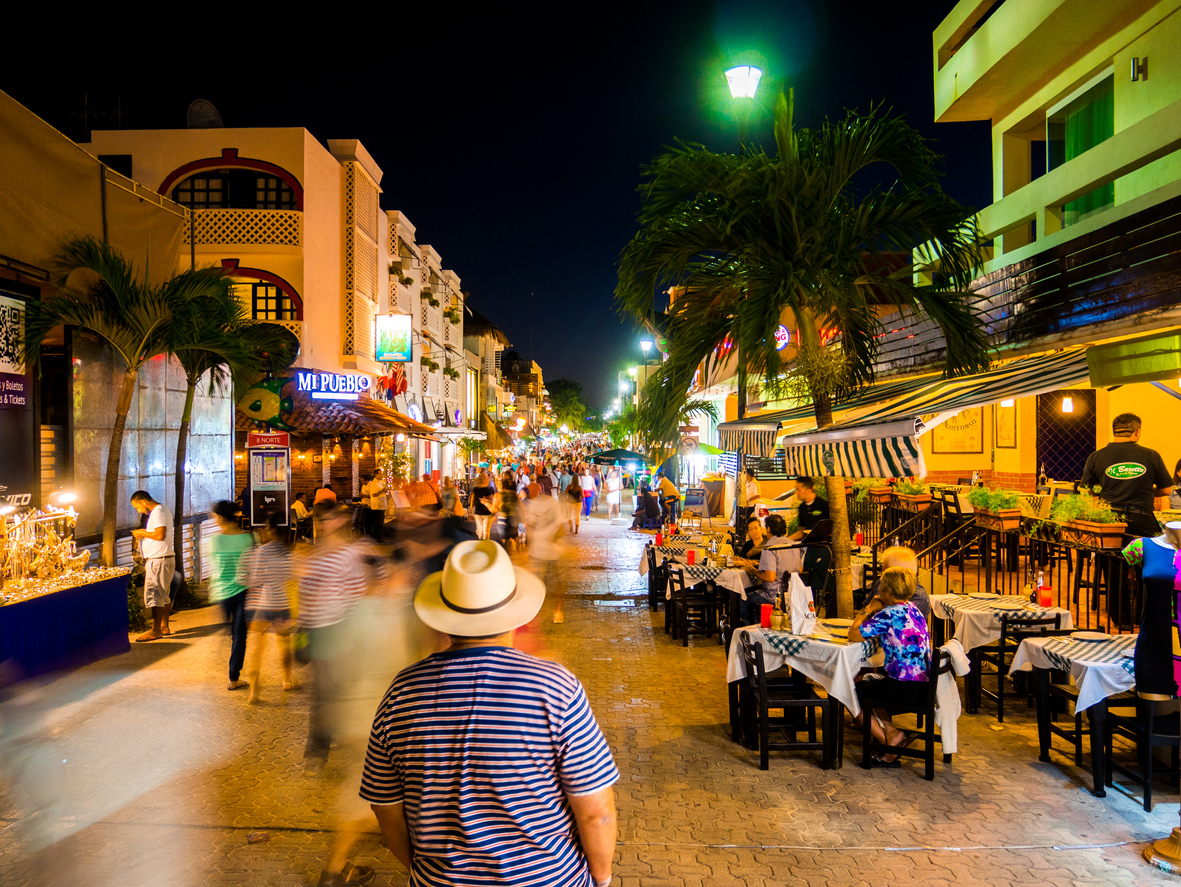 Playa del Carmen, Mexico - February 15, 2014: People walking around the lively Calle Quinta Avenida at night in Playa del Carmen, Mexico.