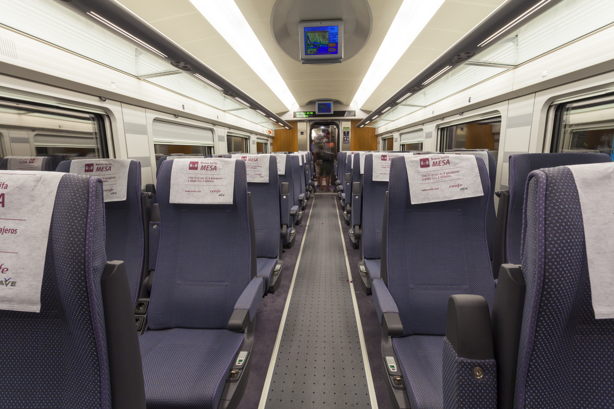 Malaga, Spain - July 25, 2011: Interior view of an AVE train operated by the Spanish company Renfe as it arrives in Malaga on the route from Barcelona. Passengers can be seen leaving the carriage.