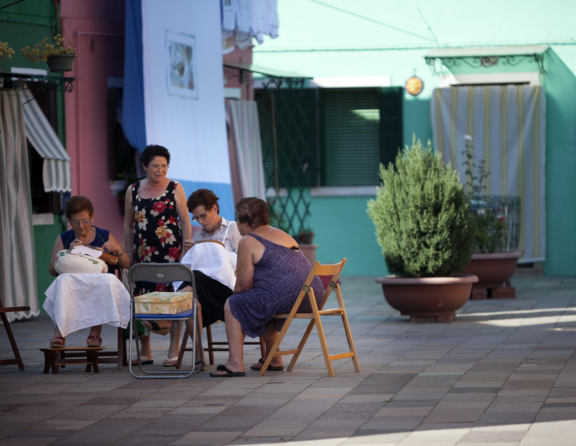 """""""Venice, italy - August 13, 2012: Four women making lace on the Island of Burano, Venice, Italy. Burano is an island in the Venetian Lagoon, northern Italy and is known for its lacework and brightly coloured homes."""""""