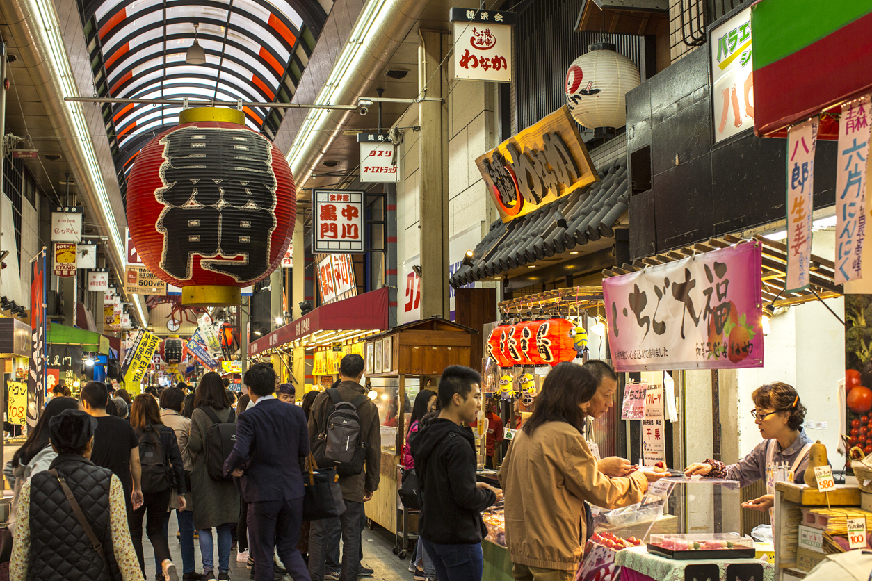 Osaka, Japan - October 22, 2018: The Kuromon Ichiba is a spacious market with vendors selling street food, fresh produce and shellfish, plus souvenirs. It is located at the center of Osaka city near Nipponbashi station.
