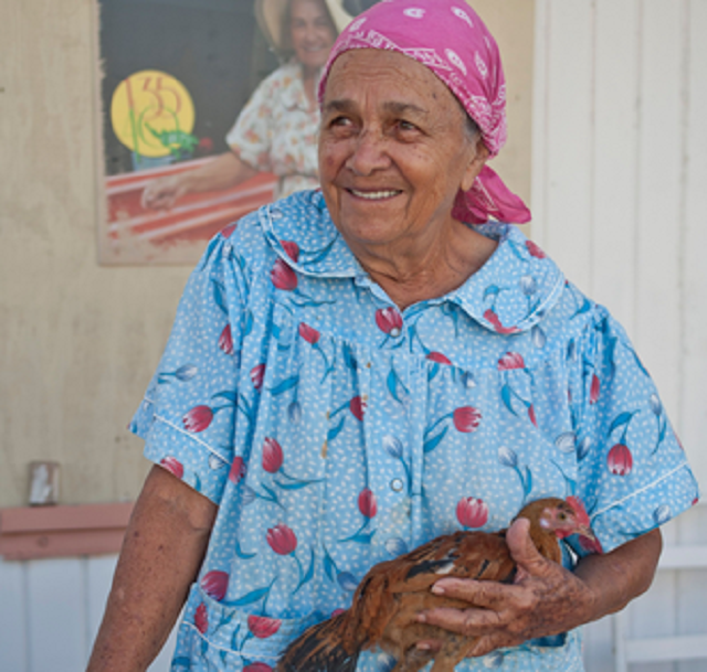 L2F May 19 pic Puerto Rico dining travel book old lady with chicken