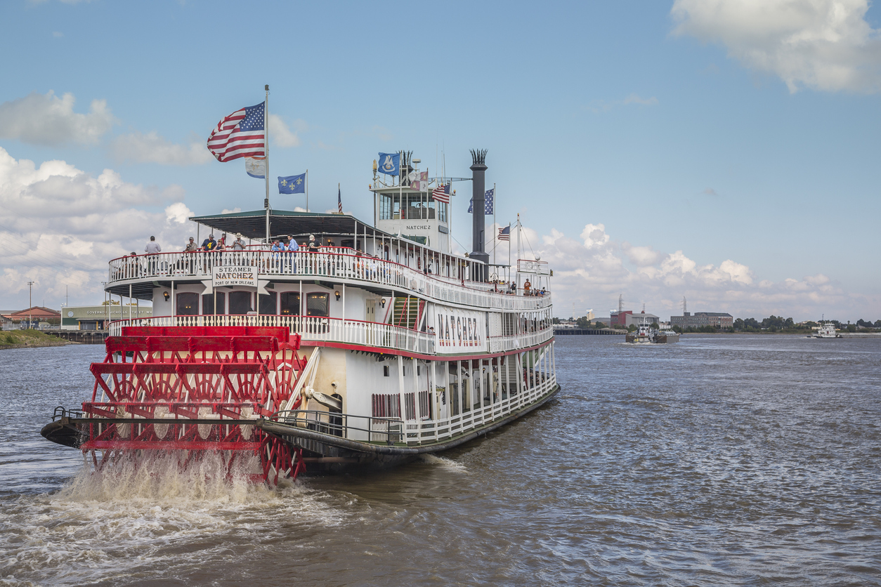 Steamer Natchez along the Mississippi River in New Orleans. The 9th Natchez to be built serves as a tourist cruise boat along the Mighty Mississippi. A popular tourist activity in New Orleans is to cruise on a steamboat along the Mississippi River.