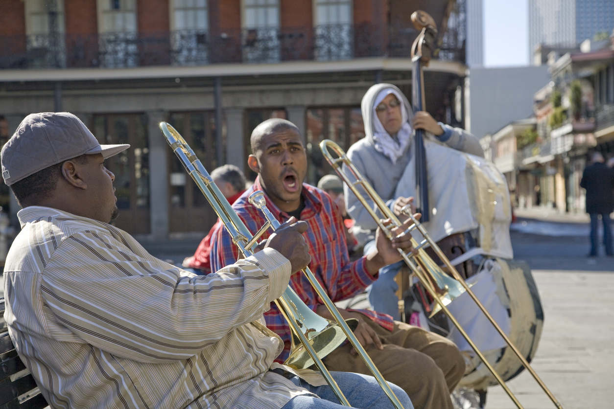 New Orleans, LA, USA - December 27, 2006: A Jazz band plays trombones and stad up bass in Jackson Square on December 27, 2006 in New Orleans, LA, USA.