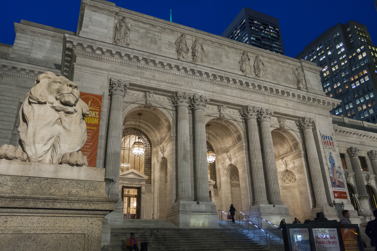 New York, NY, USA - November 5, 2014: the exterior evening view of New York Public Library (also known as Stephen A. Schwarzman Building), opened in 1911 and built in Beaux Arts style.