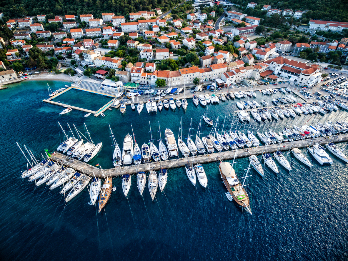 Aerial view on Korcula town with marina and moored sailboats and yachts. Shot from a drone Phantom 3 Professional. Island Korcula, Dalmatia, Croatia. http://santoriniphoto.com/Template-Sailing.jpg
