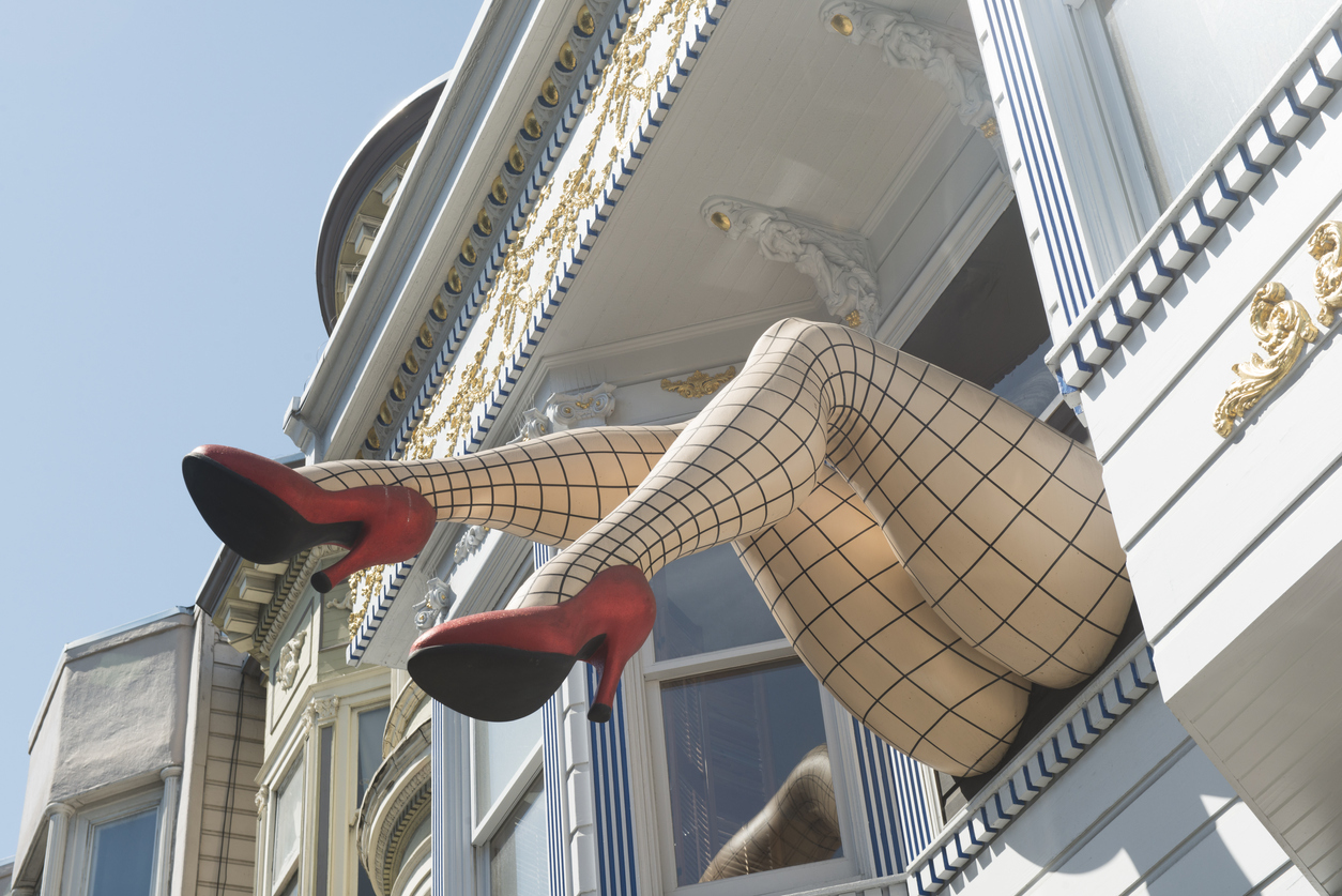 In San Francisco, USA a pair of giant legs wearing red high heels and fishnet stockings sticking out of the second floor of a Victorian building on the famous Haight Street are a local landmark.