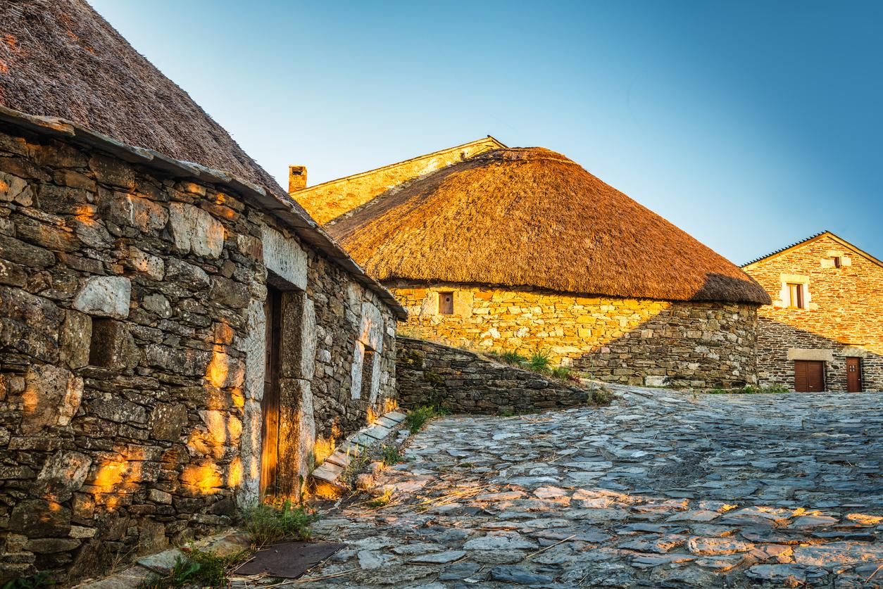 O Cebreiro, Spain. Historic stone huts at sunset