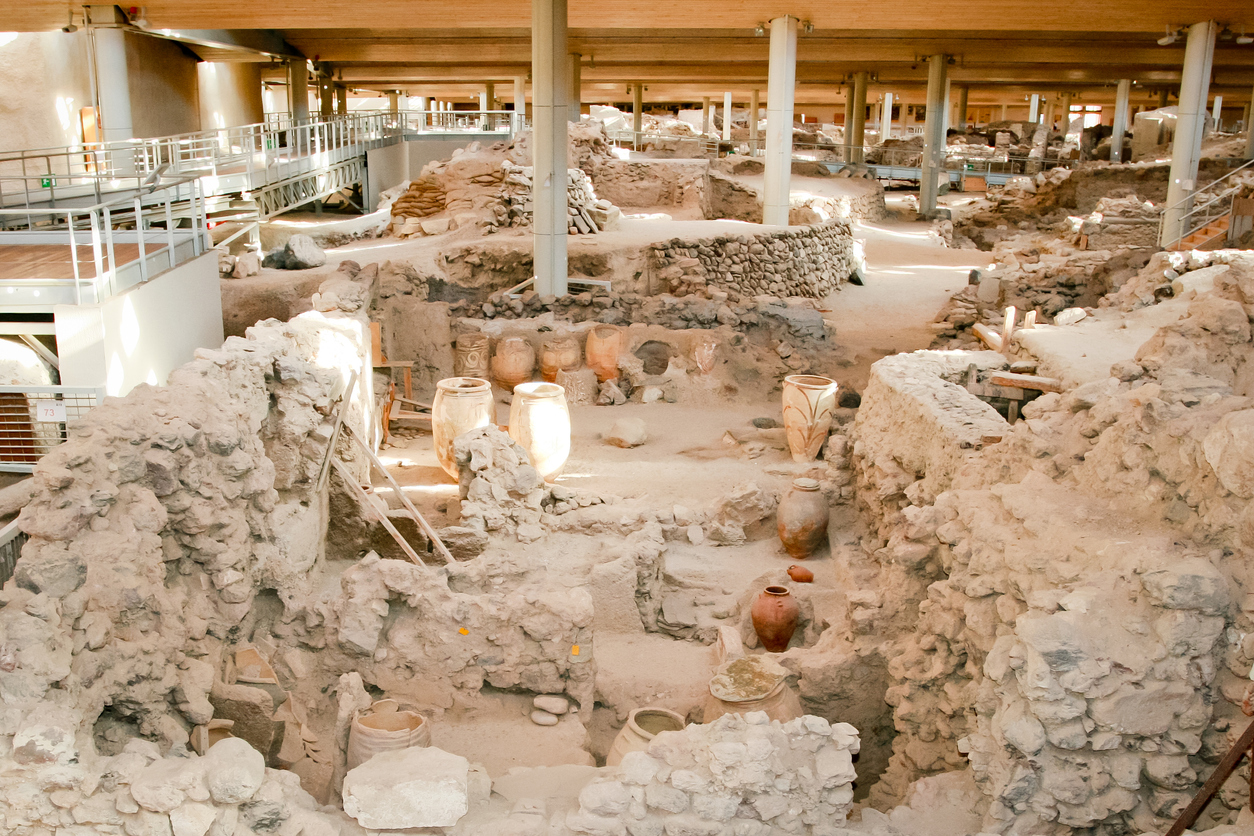 Santorini, Greece - June 26, 2015: Akrotiri is an archaeological site from the Minoan Bronze Age on the Greek island of Santorini (Thera). Photo of recovered aincient buildings and decorated pottery.