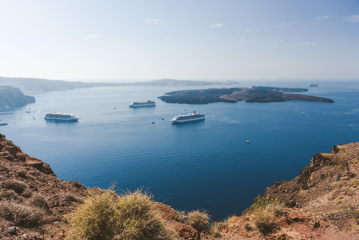 Santorini, Greece - October 3, 2018, Santorini island, view from Fira over caldera, towards Nea Kameni and with cruise ships in the port
