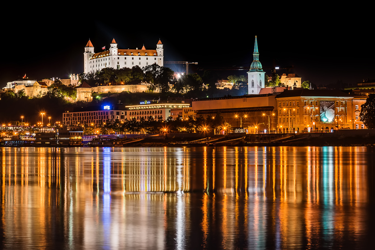 Bratislava, Slovakia May 23, 2018: Bratislava at night, with the city lights reflected in the Danube river. On the top hill stands the Bratislava Castle built in the 9th century.