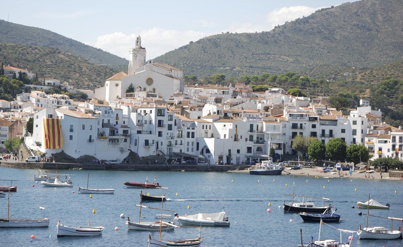 View of port of Cadaques on costa brava in Spain.Celebration days of Catalonia with all the flags.