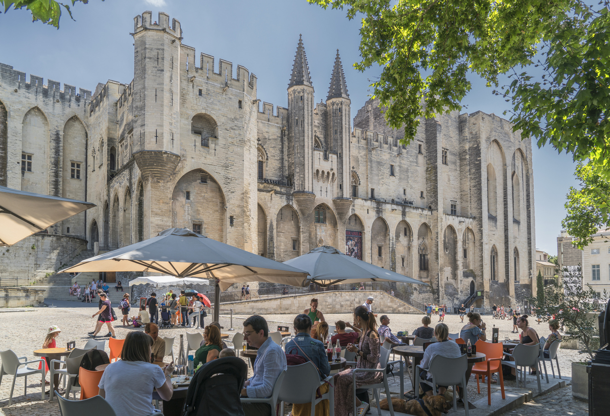 France. Avignon. July 2nd, 2018. Tourists sitting in an outdoor restaurant under the Popes Palace