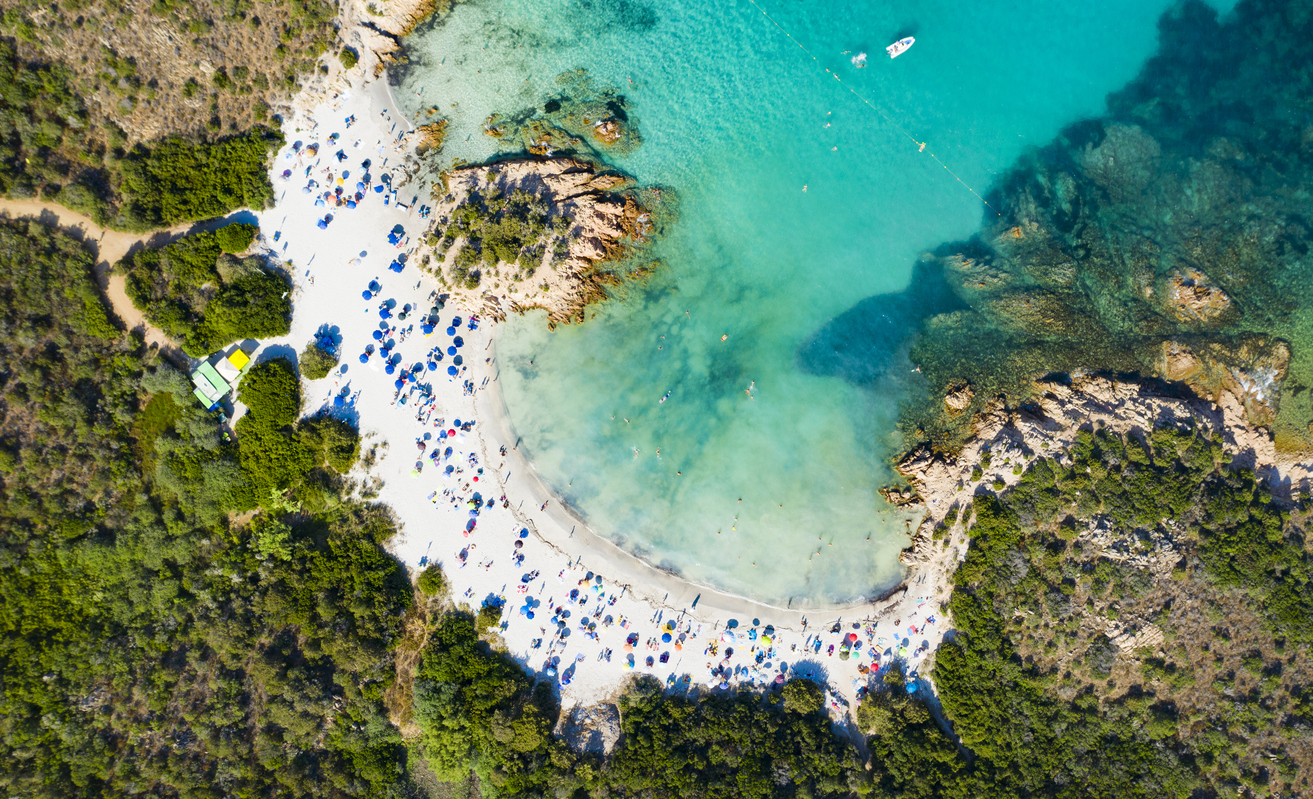 View from above, stunning aerial view of a beautiful beach bathed by a turquoise clear sea. Spiaggia del Principe, Costa Smeralda (Emerald Coast) Sardinia, Italy.