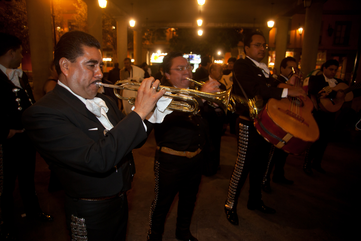 Mariachi musicians play mexican music at Garibaldi Square in Mexico City. This is a place where locals come to celebrate and commiserate with music.