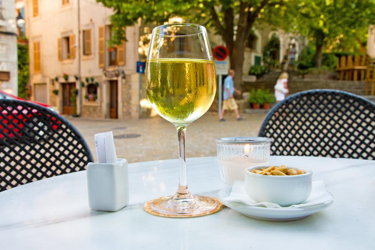 Drinking white wine in bar on Valldemossa