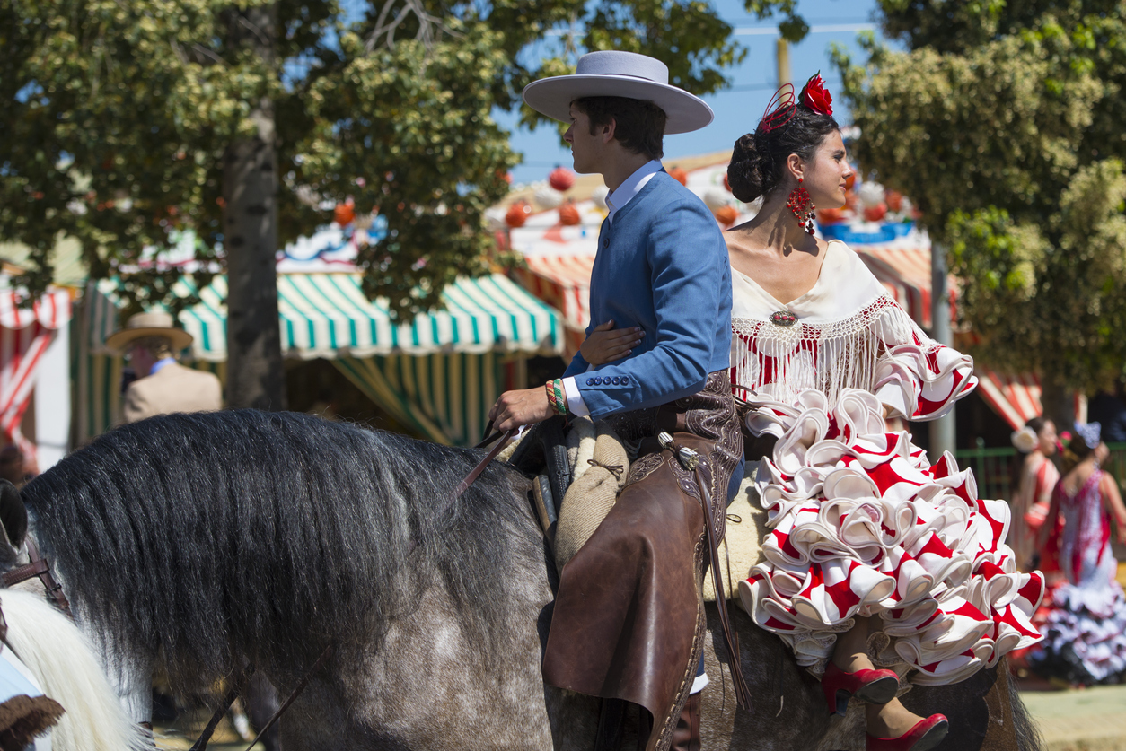 Seville, Spain - May 8, 2014: People mounted on horse on fair of Seville.