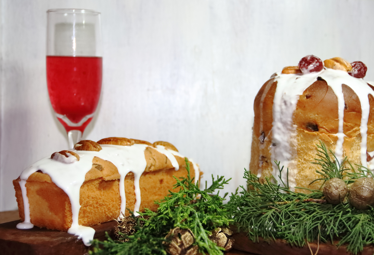 sweet bread Christmas pudding cin dried and glazed fruits and sparkling beverages