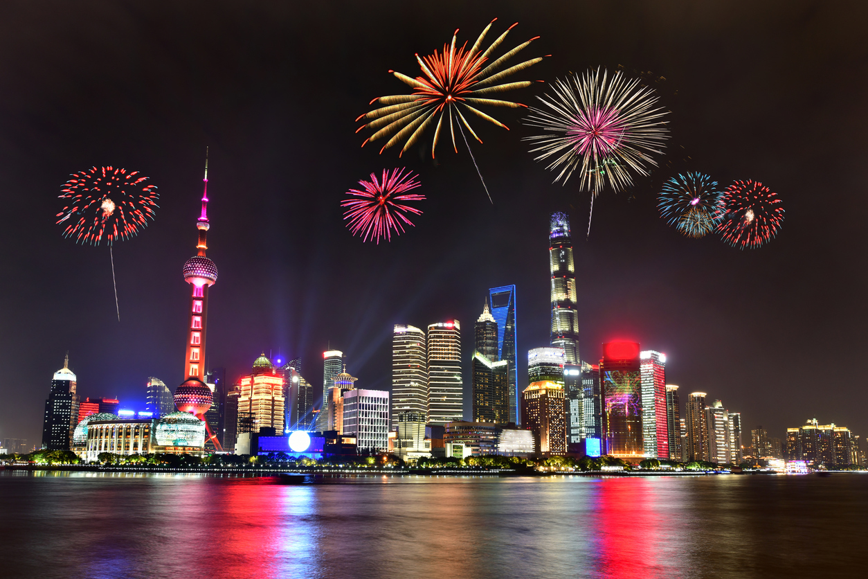 Beautiful fireworks in Shanghai cityscape with the city lights on the Huangpu River, China