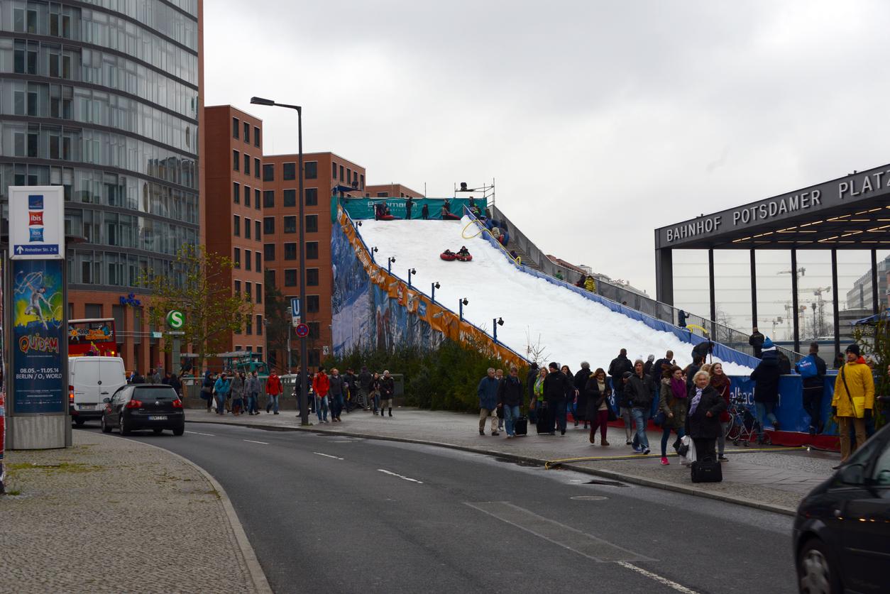 Berlin, Germany, 11/23/2013 artificial ski slope for tubing at Christmas fair in Berlin, Potsdamer Platz