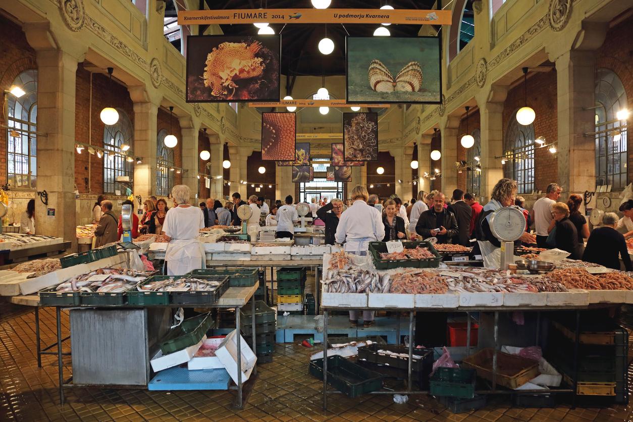 Rijeka, Croatia - October 17, 2014: Shoppers at Fish Market in Rijeka, Croatia.