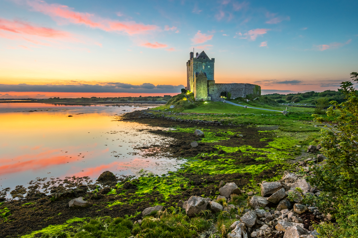 Dunguaire Castle on the shores of Galway Bay Ireland during a beautiful sunset