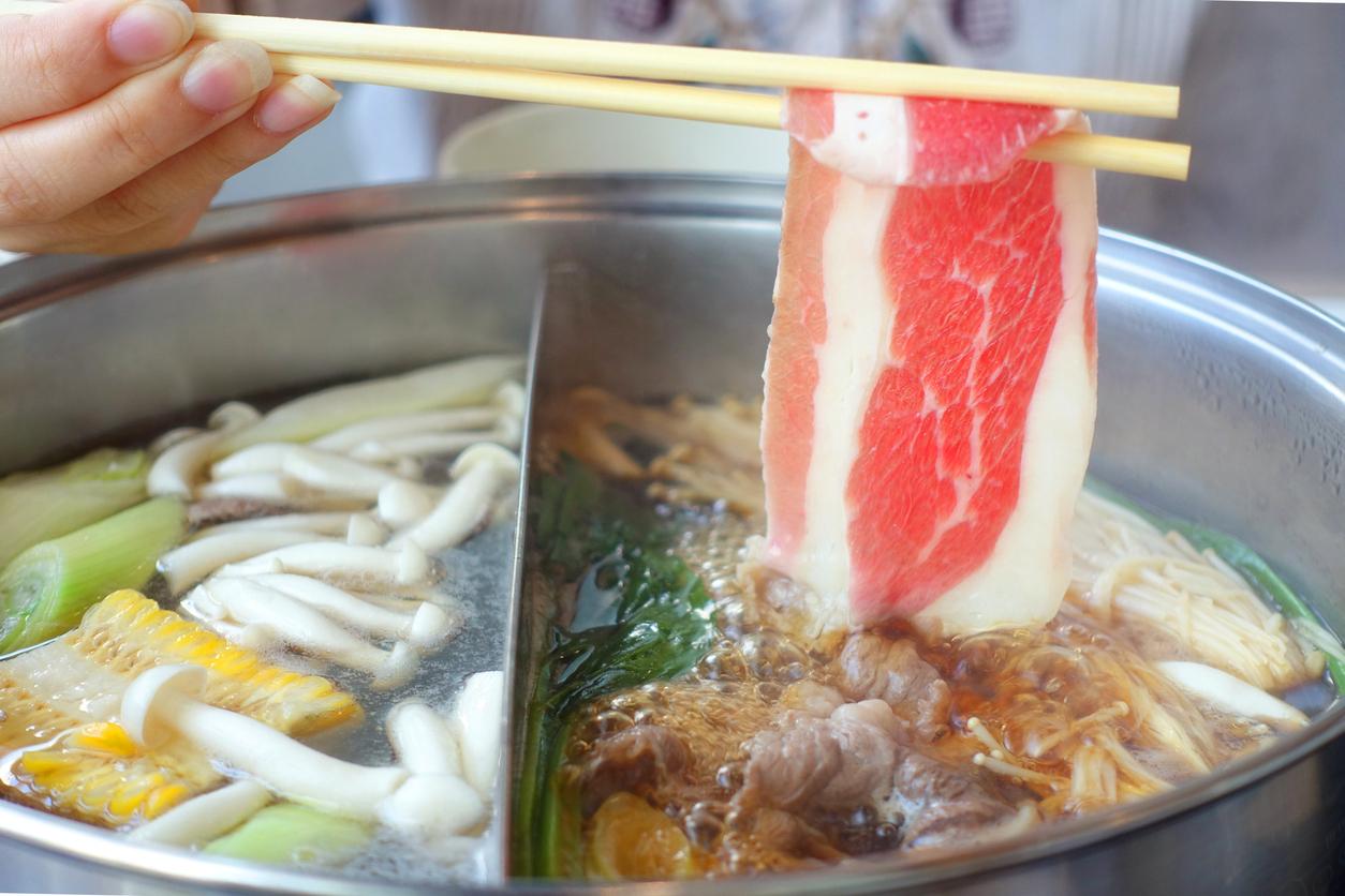 Chopstick with beef Shabu Shabu as japanese suki yaki.