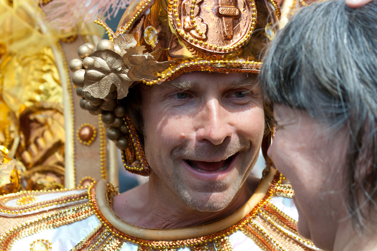 """""""Copenhagen, Denmark - May 26, 2012: Smiling male participant in the Copenhagen carnival 2012 mingling with the spectators"""""""